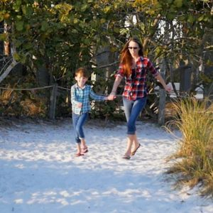 Army JAG Corps veteran Whitney Bradfield and daughter Evelyn on SIesta Key Beach