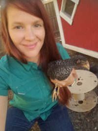Ferrera with her chicken Randy at Floaty's Farm.