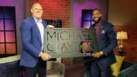 Troy Underwood presents custom metal art to former Tampa Bay Buccaneers WR Michael Clayton.